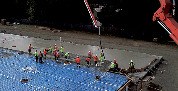 aerial view of workers smoothing concrete