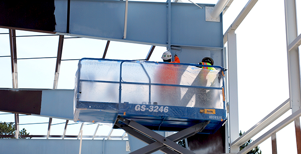 crew members painting gym steel
