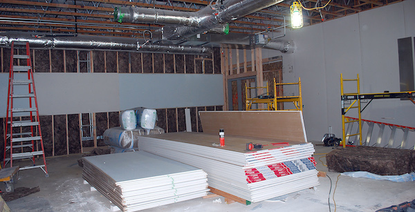 Sheetrocking of classroom interior