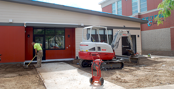 West side of modular building being cleaned