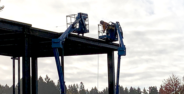 crew members working on the structure rooftop
