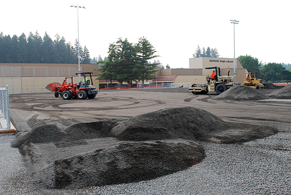 Leveling out base gravel on Glencoe turf field