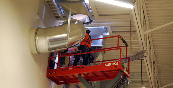 installing HVAC ductwork in gym