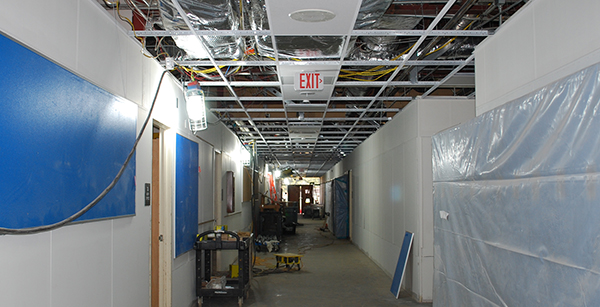 exposed ceiling and HVAC ductwork in math/science building hallway