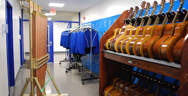 band uniforms and instruments in drama/music building hallway