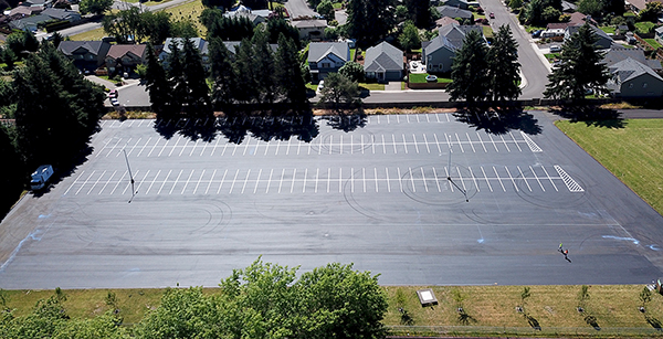 aerial view of re-paved student parking lot