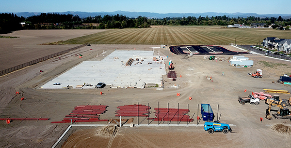 aerial view of site with structural steel laydown