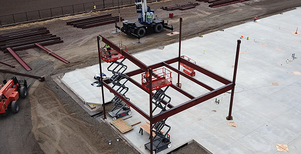 steel beam being craned to position
