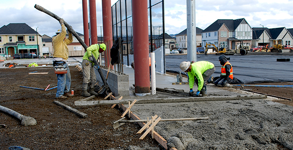 pouring concrete for covered play structure perimeter