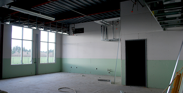 sheetrocking in first-floor classroom