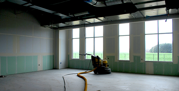 concrete polisher in unfinished classroom