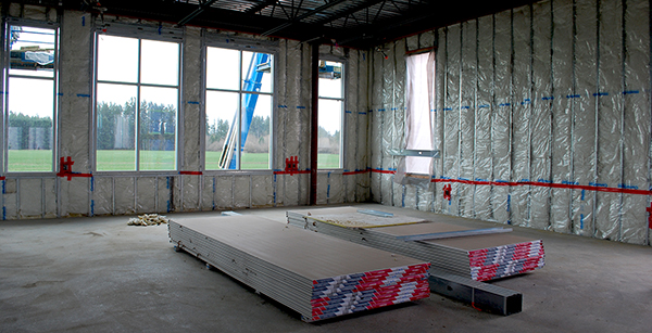 stack of sheetrock to be installed in classroom