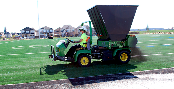 dispensing crumb rubber onto turf field