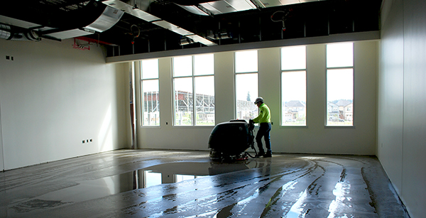cleaning concrete floor in classroom