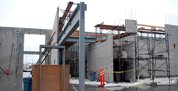 structural steel beam along interior wall construction