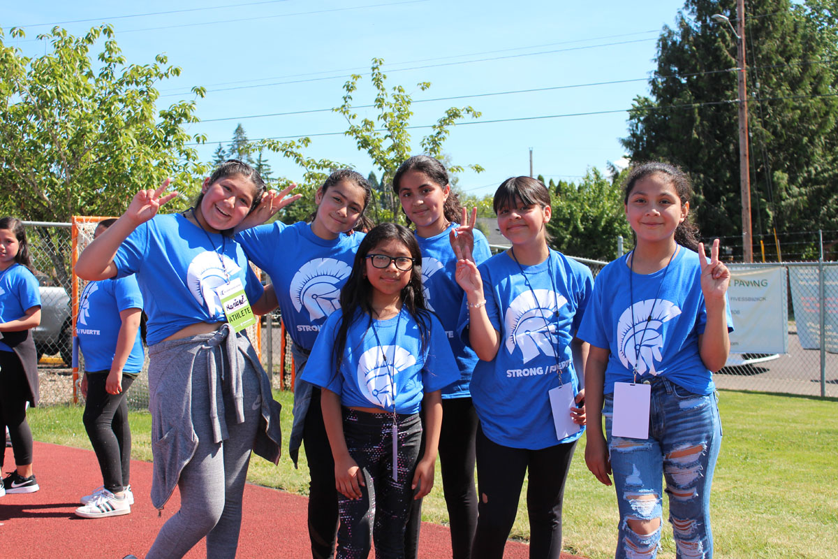 Group of girls wearing Hilhi shirts at Hillsboro Healthy Kids Track Meet
