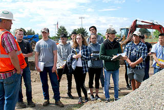 Students in the sustainable agriculture and design classes toured their new building's project site